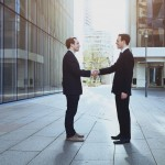 cooperation concept, handshake of two business men